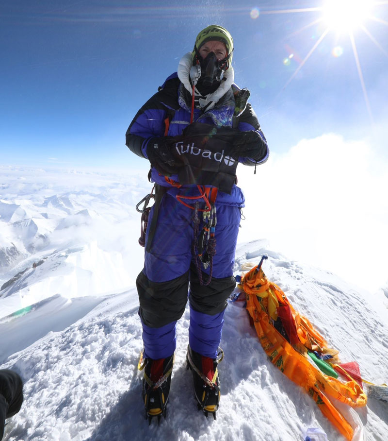 Tim Mosedale flying the Tubado flag atop of Mount Everest, 8,848 M.